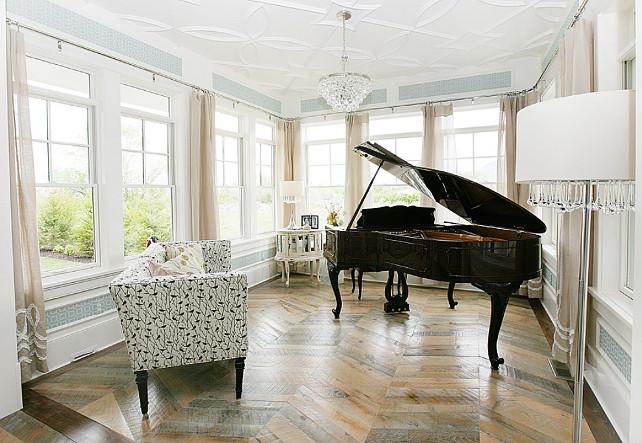 "Herringbone pattern hardwood floors. Music room with Herringbone pattern hardwood floors, black grand piano, Robert Abbey Bling Chandelier and mirrored cabinet. Wallpaper is ""Thibaut Bentley in Seamist"". #Herringbonehardwoodfloors"