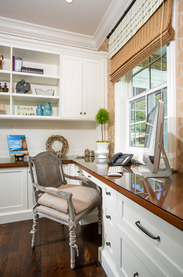 Home Office Workstation with built-in desk and cabinets. Window shades. #HomeOffice #Workstation Legacy Custom Homes, Inc.