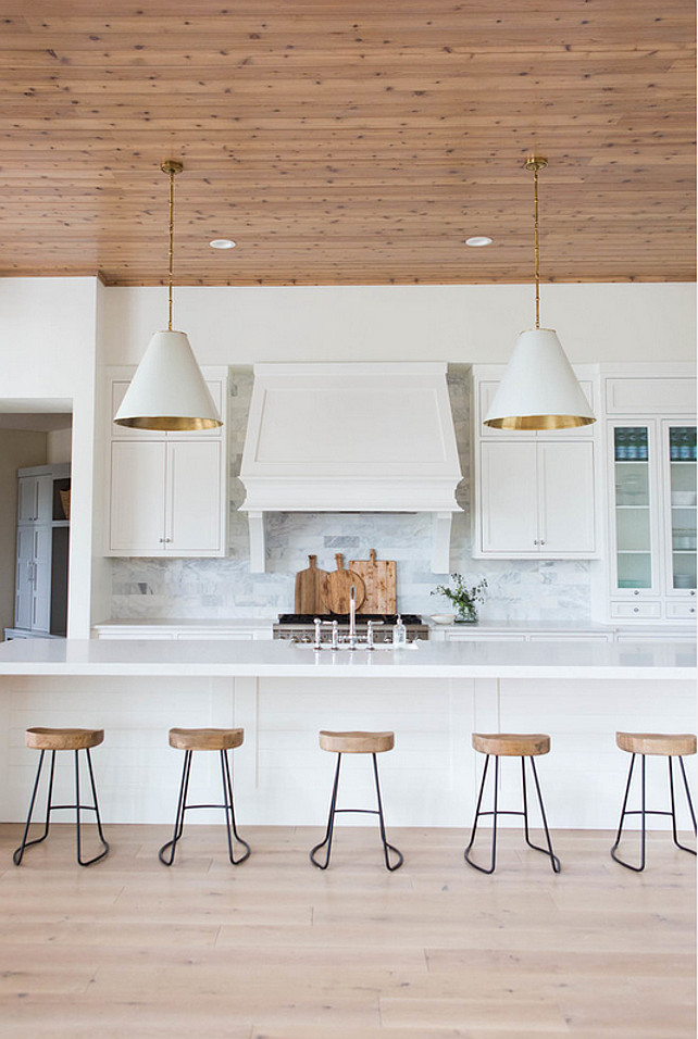 How to Design a Transitional White Kitchen. To design a transitional white kitchen you have to make sure to warm the space up with wood and natural elements. #Kitchen #WhiteKitchen