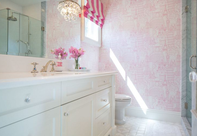 Kids bathroom with wallpaper. This white and pink kid's bathroom features pink Parisian wallpaper and Robert Abbey Bling Sconces. #Kids #Bathroom #Wallpaper Kelly Nutt Design.