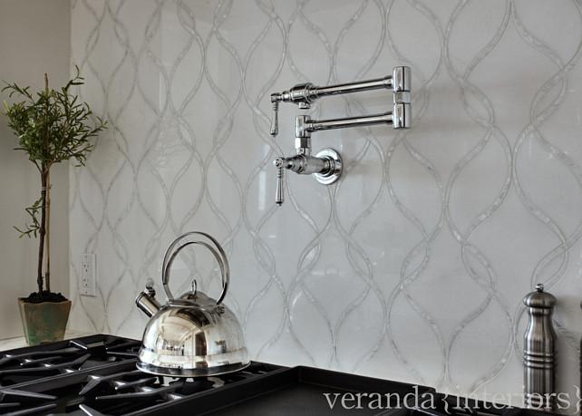Kitchen Backsplash. The kitchen backsplash is a combination of mother of pearl and white thassos marble by Artistic Tile. #Kitchen #Backsplash #WhiteMarble #TassosMarble  Veranda Estate Homes & Interiors