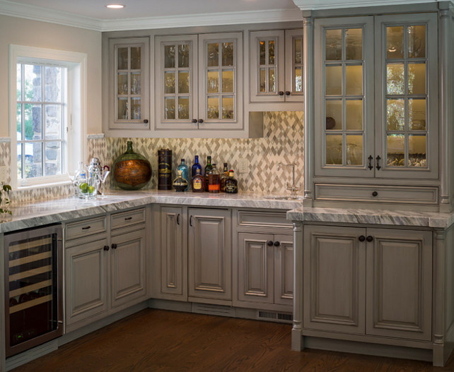 Kitchen Bar. Kitchen bar across from the kitchen, in the family room. Rhomboid mosaic blend of stone and crackled glass. Mini wine fridge and prep sink. #KitchenBar #Kitchen #Bar Brownhouse Design.