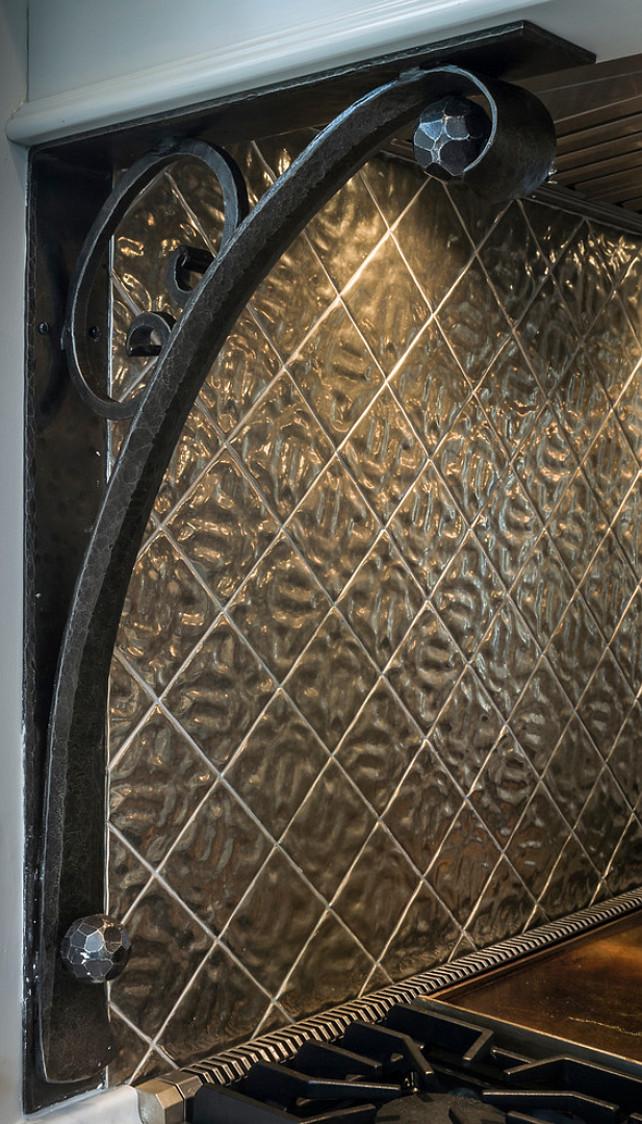Kitchen Corbels. Custom designed and hand forged Iron Corbels support Hood, metal tiles on backsplash by Rocky Mountain Hardware. #Kitchen #KitchenHood #corbel #MetalBacksplash