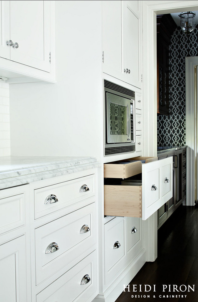 Kitchen Cabinet. Two pots and pans drawers built extra wide and very deep under the microwave allow the homeowners to maximize storage in the open kitchen. The drawers also have a special shallow roll-out that holds lids. #Cabinet #Kitchen #KitchenCabinet