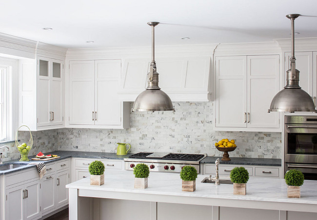 Kitchen Countertop combination. Kitchen perimeter and island countertop combination. Perimeter is Classic Soapstone. Island is Calacatta Gold Marble in Honed Finish. Connecticut Stone.