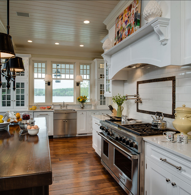 Kitchen Countertop. Kitchen Countertop Ideas. The perimeter countertop in this traditional kitchen is white marble and the countertop on the island is a thick butcher's block. #Kitchen #KitchenCountertop