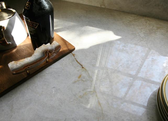 Kitchen Countertop. Kitchen Taj Mahal Quartzite Countertop. Taj Mahal Quartzite. #TajMahalQuartzite Barbara Brown Photography. Bell Kitchen and Bath Studios.
