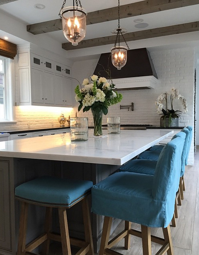 Kitchen Countertstools. Linen slip covered counter stools. Turquoise linen slip covered counter stools. #linenslipcoveredcounterstools Graystone Custom Builders