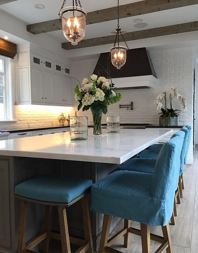 Kitchen Countertstools. Linen slip covered counter stools. Turquoise linen slip covered counter stools. #linenslipcoveredcounterstools Graystone Custom Builders