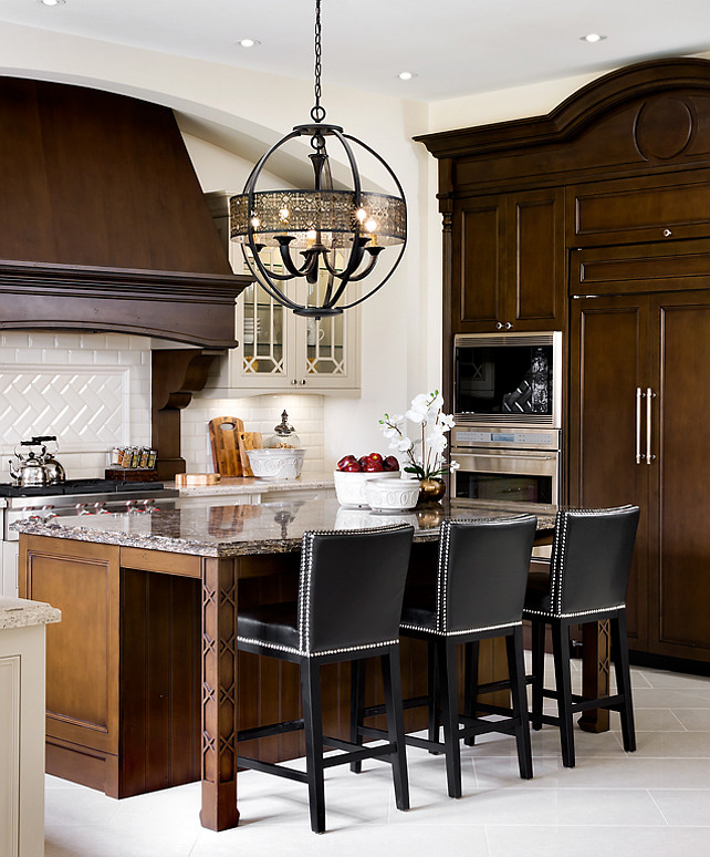 "Kitchen Design Ideas. French Kitchen. Great dark stained kitchen cabinets with arches and cabinet trim details. Light Fixture above island is the ""Eurofase 19368-016 Arsenal 5-Light Chandelier"". #OrnateKitchenDesign #FrenchKitchen #Kitchen Designed by Jane Lockhart."