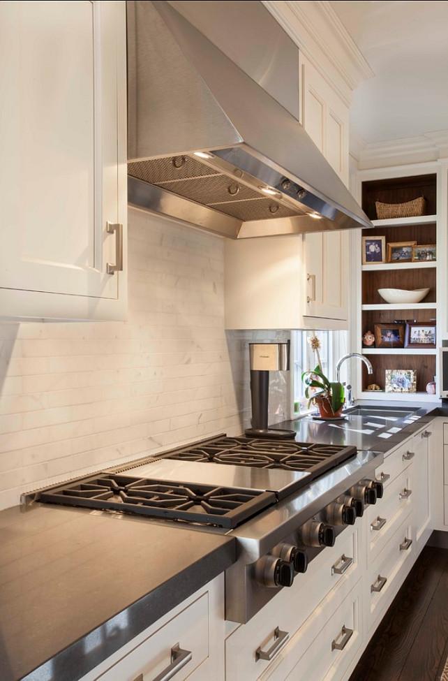Kitchen Design Ideas. Kitchen Hood, Kitchen Cooktop, Kitchen Backsplash, Kitchen Cabinets. The countertop in this kitchen is Cesarstone. #Kitchen #KitchenIdeas #KitchenDesign  Designed by John Johnstone Kitchen & Bath Designers.
