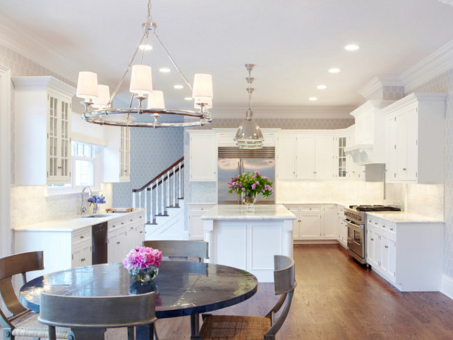 Kitchen Design Ideas. Polished nickel was used as the prominent metal for all light fixtures in the kitchen area. Walls were wallpapered with a soft pattern of lilac, white color and wallpaper. #KitchenDesignIdeas #KItchen