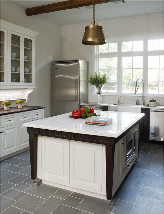 "Extendable Kitchen Island. Beautiful kitchen design ideas! This kitchen has crisp white cabinets and an extendable kitchen island design. Pendants are the ""Single Sloane Street Shop Light With Metal Shade"" in antique brass. #Kitchen. #KitchenIsland #KitchenDesign"
