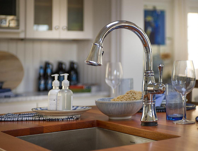 Kitchen Faucet Ideas. Sink Faucet. A classic chrome faucet features a single pull-down handle as well as modern touch technology that makes it easy to run the faucet even when hands are full. #Kitchen #Faucet #SinkFaucet #KitchenFaucet