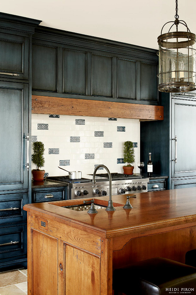 "Kitchen Hood. Kitchen Range Hood. The professional 48"" six-burner range from Wolf was selected to support the needs of a high performing chef. A distressed, reclaimed-looking beam is above the range. #Kitchen #KItchenHood #KItchenHoodIdeas #Hood #Range"