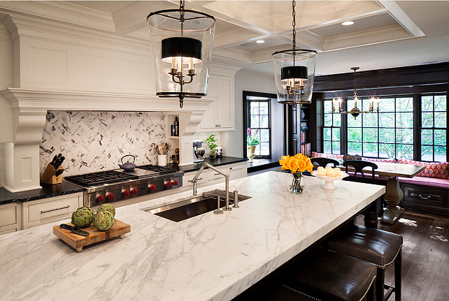 Kitchen Ideas. Kitchen Design. Kitchen Design Ideas. Kitchen features ample custom storage, a built-in banquette, and a large kitchen island to accommodate entertaining. These pendants are by Vaughan Designs (Zurich Lantern). #Kitchen