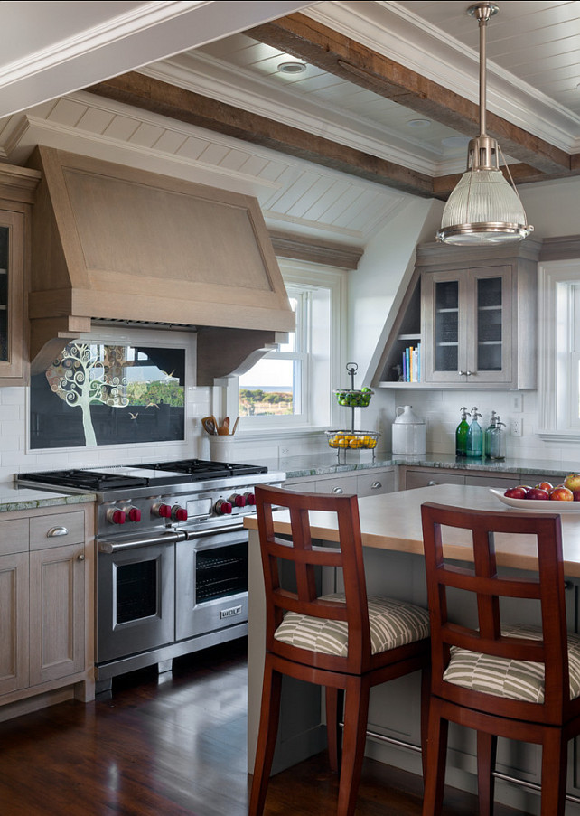 "Kitchen Ideas. Grey washed kitchen cabinets with beautiful ceiling.What really grabs your attention in this kitchen is the reclaimed wood beams and planked ceiling. The countertop in this kitchen is honed granite and the island is stained wood. Island pendant are the ""Haverhill Pendant by Hudson Valley Lighting"". #KitchenIdeas. #Kitchen"