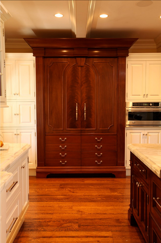 Kitchen Ideas.The wood is Honduran mahogany, with the panels where the pulls are being done in a crotch mahogany cut of veneer. #KitchenIdeas. #KitchenDesign #LuxuriousKitchens
