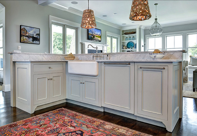 Kitchen Island Design. Island cabinet design. Kitchen island with gray cabinets, apron sink and nickel hardware. #kitchen #KitchenIsland #Islandcabinet