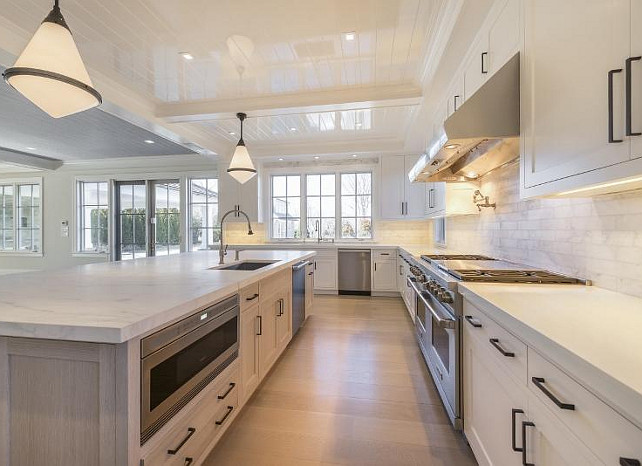 Kitchen Island Lighting. Kitchen island lights. Kitchen island pendant light. Kitchen island pendants. #KitchenIslandLighting Michael Davis Design and Construction.