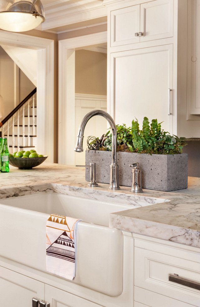 "Kitchen Island Sink. Apron Sink. Island countertop is White Arabesque Honed Marble. Kitchen Island Sink Ideas. #KitchenIslandSink #KitchenIsland #Sink  Garrison Hullinger Interior Design Inc. Faucet is the ""Quincy Pull Down Faucet by Kallista""."