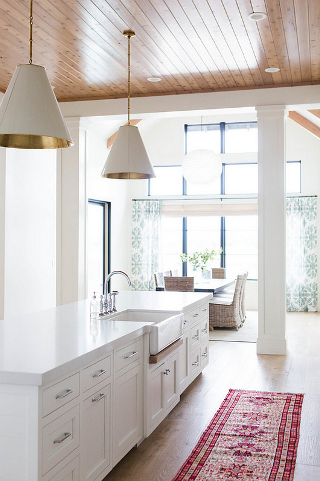 Kitchen Island with Farmhouse Sink. White kitchen island with white quartz countertop and farmhouse sink. #KitchenIsland #FamrhouseSink Ashley Winn Design.