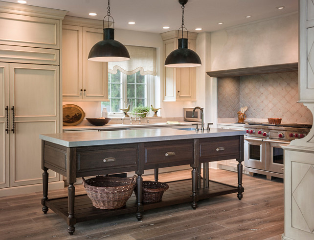 Kitchen Island. One of a kind island in fumed oak. Plumbing supply and waste pipes are sleeved with bronze pipes to match Rocky Mountain faucet finish. Hammered Zinc counter top and sink. #KitchenIsland
