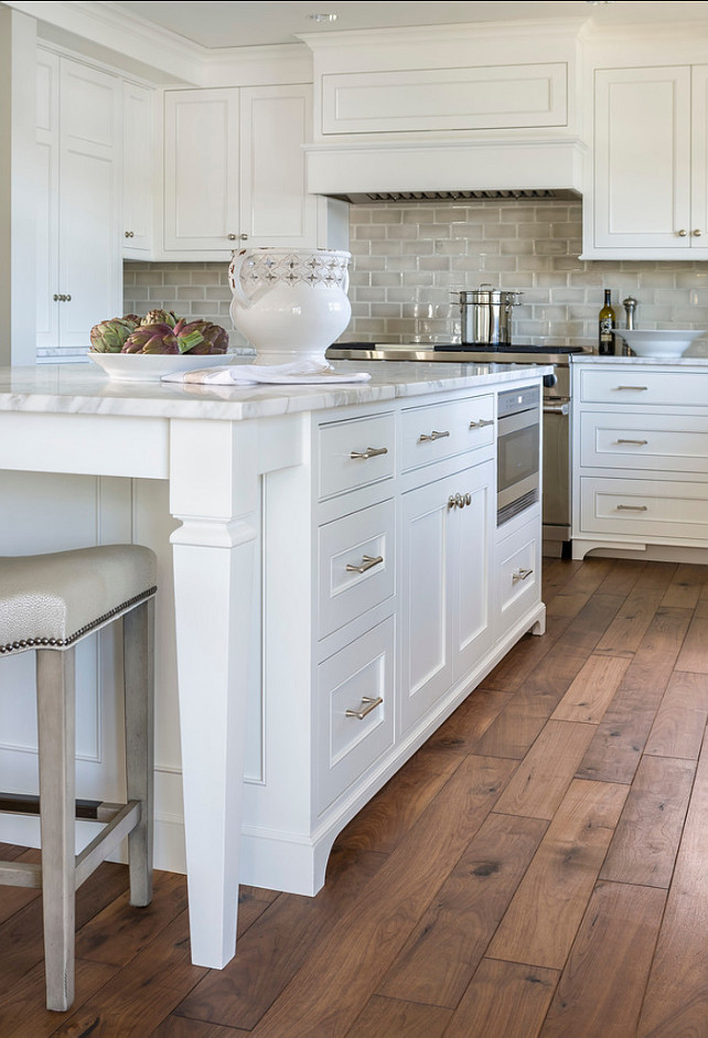 Kitchen Island. Kitchen Island Ideas. Kitchen island design. Custom kitchen island legs. Kitchen island painted Benjamin Moore Simply White accented with brushed nickel pulls along with calcutta marble counters