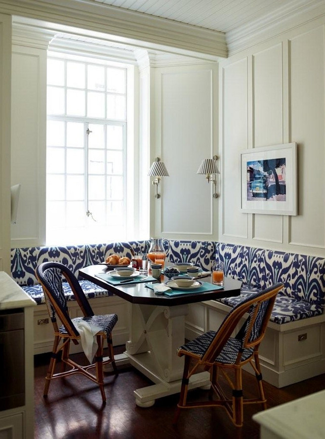 Kitchen Nook. The upholstery of the banquette seating in this kitchen adds a splash of color to the white woodwork. #BreakfastNook #banquette  Studio 511