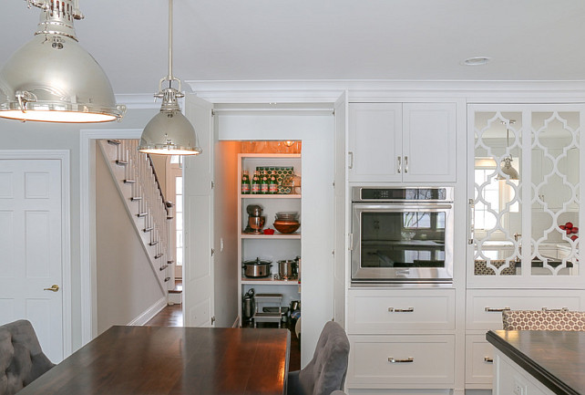 Kitchen Pantry Cabinet. Kitchen cabinet doors open to a hidden walk-in pantry. #Kitchen #Pantry #PantryCabinet #HiddenPantry #KitchenPantry  Redstart Construction.