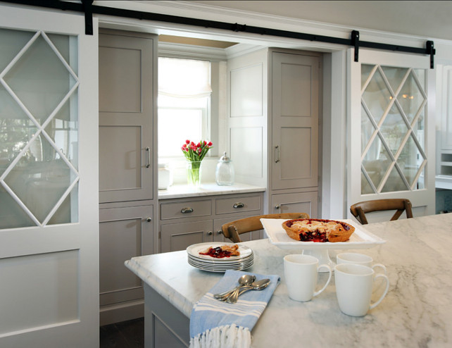 Kitchen Pantry Ideas. This kitchen features an elegant kitchen pantry with custom cabinets and double barn doors. #Kitchen #KitchenPantry #Pantry #Butlerspantry #BarnDoor