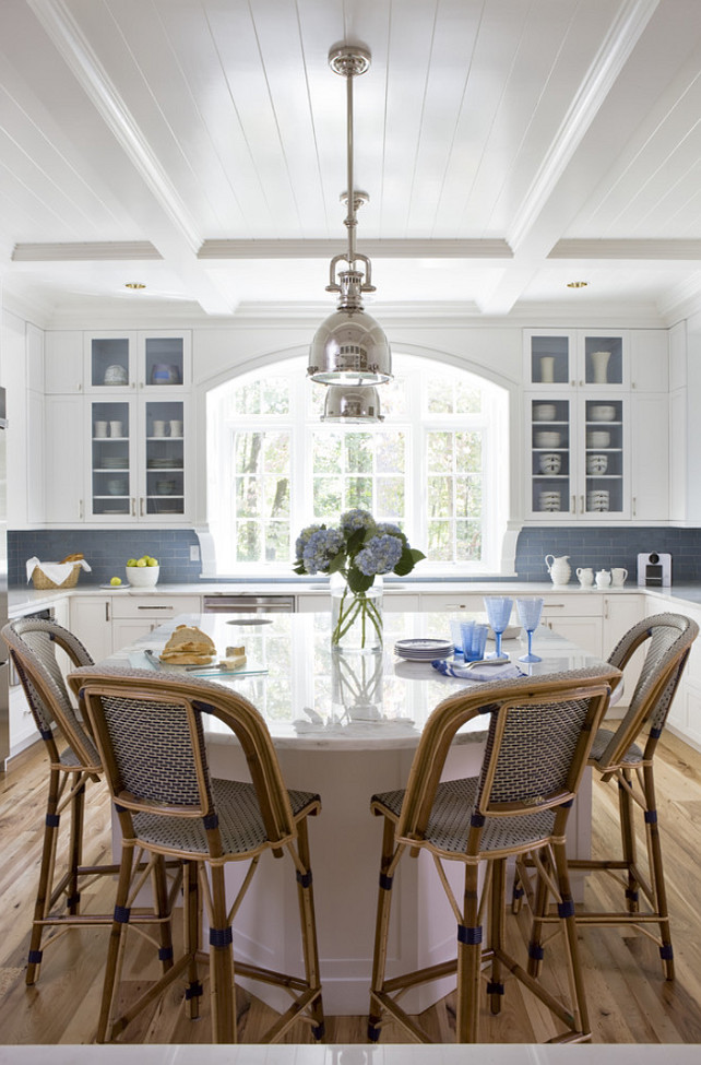 Kitchen Planning. Kitchen Sources. The kitchen floors are Antique American Hickory. Kitchen Backsplash is from Waterworks. Kitchen counterstools were imported from France. The kitchen size is approximately 17 by 18. Kitchen Layout. Kitchen Island. Kitchen Lighting. White Kitchen Paint Color. The interior of the glass front cabinets was done in Benjamin Moore Beacon Gray 2128-60. #Kitchen #KitchenPlaning #KitchenSources