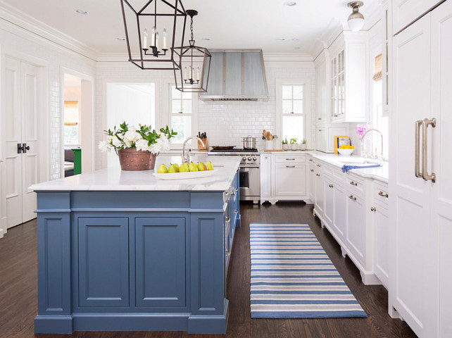Kitchen Runner. Blue Striped Runner. Blue Striped Kitchen Runner. Kitchen with blue island and striped runner with custom hood. The hood was made through the builder John Kraemer & Sons with a Wolf Pro Ventilation Hood Liner. #kitchen #Runner Martha O'Hara Interiors.