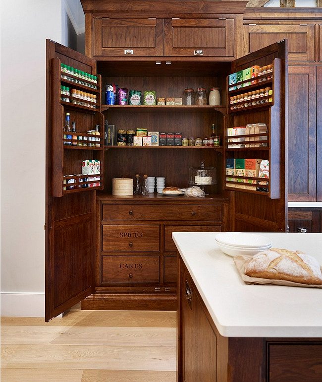 Kitchen Spice Cabinet. Kitchen cabinets are made from American walnut and offer spice racks inside. #Kitchen #Spice #Cabinet #AmericanWalnut . Humphrey Munson.