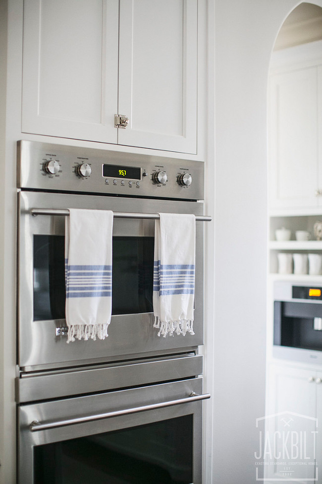 Kitchen Wall Oven Cabinet. Kitchen features stainless steel double wall ovens stacked between white shaker cabinets. Double ovens. Wall ovens. Double wall ovens JackBilt Homes.