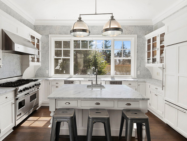Kitchen Wall Tile Ideas. Wall Tiling Kitchen Ideas. White Kitchen with tiled walls to ceiling. Via Sotheby's Homes.