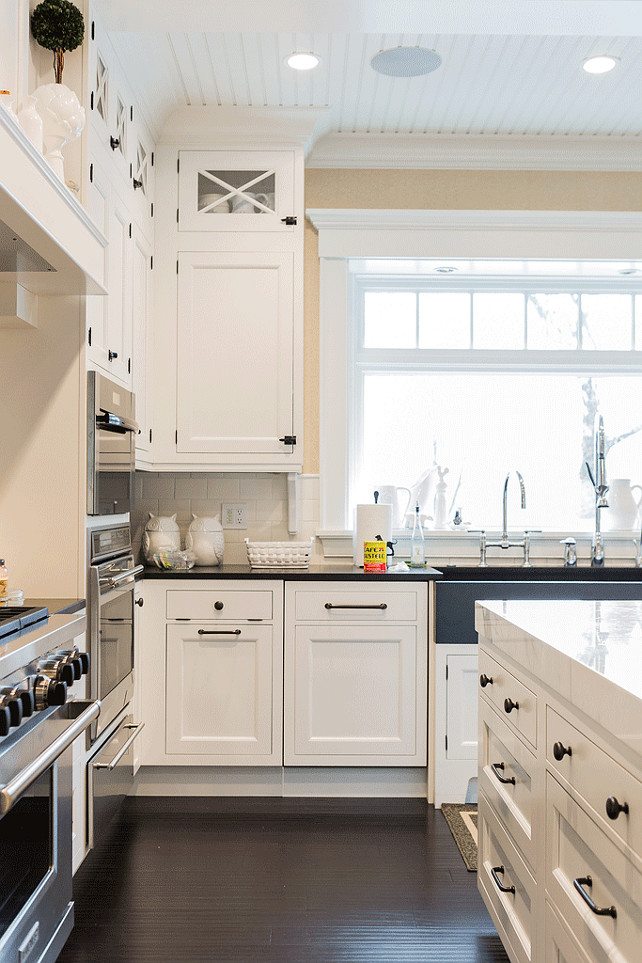 Kitchen Warm Drawer Oven. Warm drawer under oven. Warm drawer under kitchen oven. This kitchen also features beadboard ceiling with pot lights, x mullion cabinets stacked over shaker upper cabinets and shaker lower cabinets paired with black countertops and white subway tile backsplash. The backsplash is finished with pencil rail. Brookes and Hill Custom Builders.