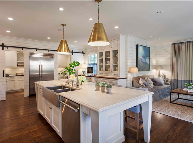 Kitchen island. Kitchen Island Countertop. Durable Kitchen countertop. Kitchen with white island and 3cm Taj Mahal Quartzite. #kitchenIsland #KitchenCountertop #DurableCountertop #TajMahalQuartzite