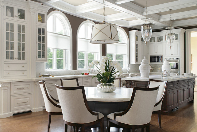 Kitchen lighting Ideas. Lighting pendants above kitchen island are the Hudson Valley Hanover 143-HN. Lighting above table is E.F. Chapman Grosvenor Large Single Pendant. #KitchenLighting #KitchenLightingIdeas.