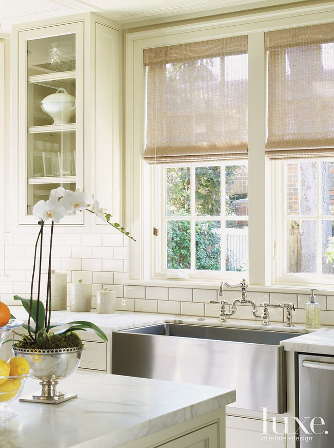 Kitchen sink and backsplash. A farmhouse sink and faucet from Fixtures & Fittings stand out against backsplash tiles from Ann Sacks. #Kitchen #Farmhousesink #Sink #backsplash Courtney Hill Fertitta.