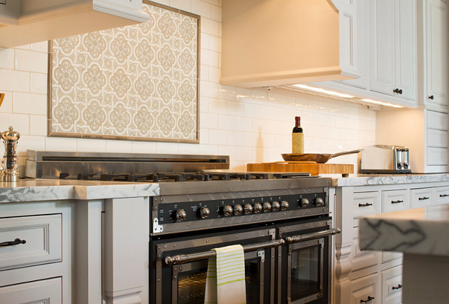 Kitchen with black Bertazonni Range. Backsplash over the range is American Tile and is called Spanish Cathedral. Backsplash is subway tile is by Daltile and is called Snowdrift. Whitestone Builders.