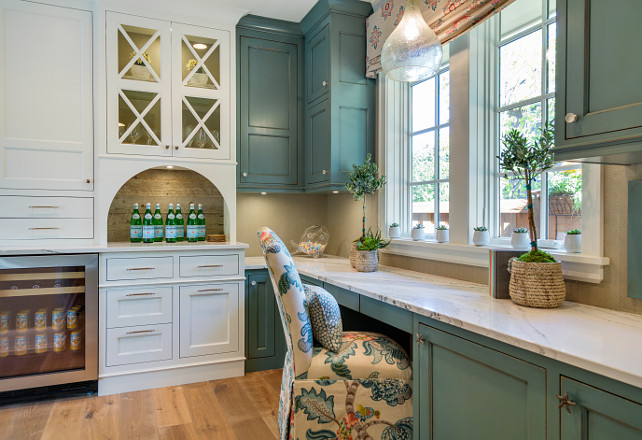 Kitchen with desk and bar. Kitchen with desk with cabinets painted in blue and kitchen bar cabinets painted in white. Walls are covered in a herringbone patterned wallpaper. Great Neighborhood Homes.