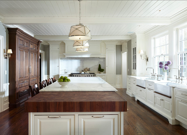 Kitchen with large island with marble and butcher block countertop. The butcher block is made of walnut. This kitchen also feautures beadboard ceilings. #Kitchen #KitchenDesign #KitchenIdeas #KitchenIsland Designed by Yunker Associates Architecture.
