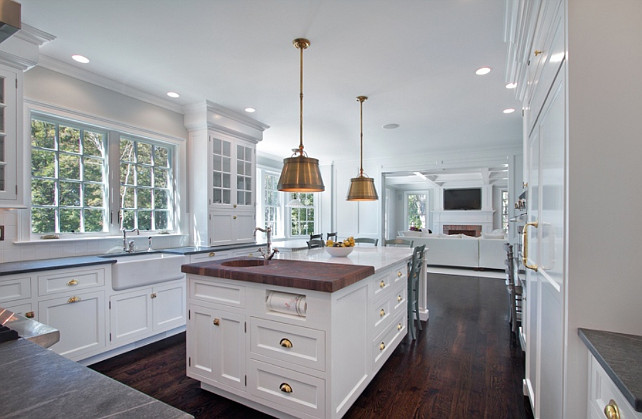 Kitchen with with antique brass hardware and Visual Comfort Lighting Single Sloane Street Shop Lights with Metal Shades in Antique Brass. #AntiqueBrass #Hardware #Lighting  Blue Water Home Builders.
