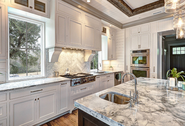 Kitchen. Countertop bar sink, Kitchen beamed ceiling, glass pendant lights, gray countertop, prep sink, recessed lighting, rustic wood ceiling beams, wall ovens. Ink Architecture.