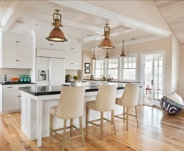 Kitchen. Kitchen Ideas. White kitchen with coastal decor. Light fixture pendants are salvage ship lights #Kitchen #KitchenLighting #Lighting #Pendants #IslandPendants#Kitchen #CoastalKitchen #KitchenIdeas