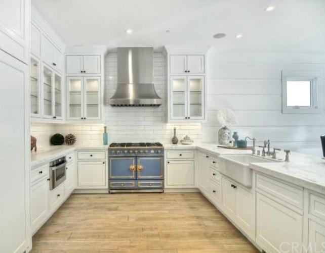 Kitchen. White Kitchen with blue range. White Kitchen cabinets. White Kitchen with wide plank hardwood floors. #WhiteKitchen #Kitchen