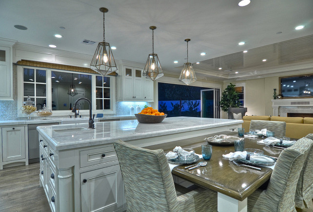 Kitchen. White Kitchen with spacious island. #Kitchen #KitchenIdeas #WhiteKitchen #KitchenIsland Kitchen Countertop. Marble Countertop Ideas. Themarble countertop in this kitchen is Calacutta Premium. #MarbleCountertop #KitchenCountertop #Calacutta #Marble .