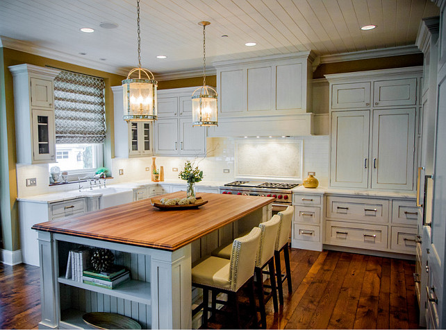Kitchen. White Kitchen. Transitional White Kitchen with white marble countertop and large kitchen island. The counter stools are from Sunpan Imports. #Kitchen #WhiteKItchen #TransitionalKitchen #KitchenIdeas #KitchenDesign