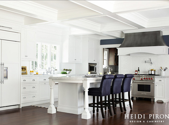Kitchen. White Kitchen.  White kitchen with large island and custom hood. #Kitchen #WhiteKitchen Heidi Piron Design & Cabinetry.